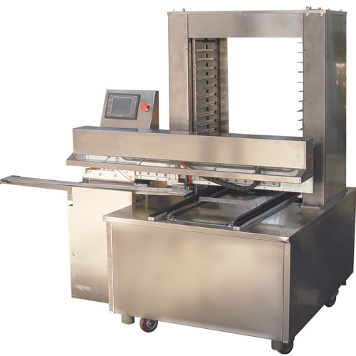 The Panmatic 6040 is the versatile panning machine created to perform the tedious work of carefully placing products on to trays